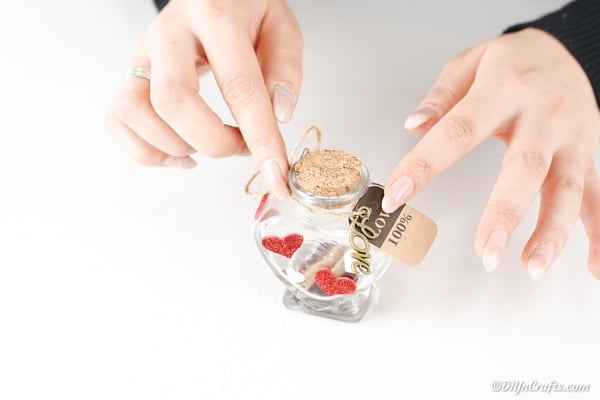 Attaching gift tag to message in a jar
