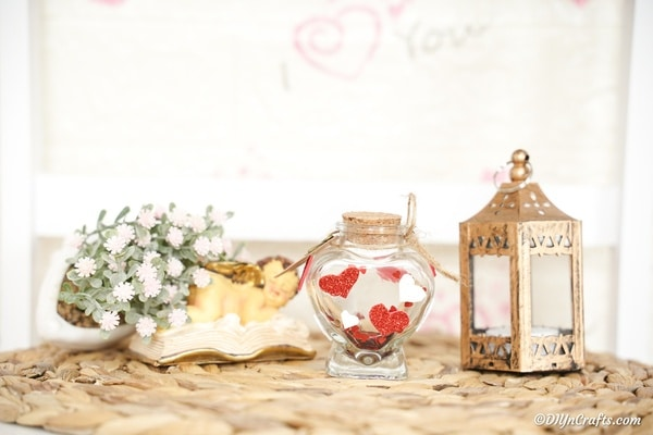 Message in a bottle jar on a shelf with lantern