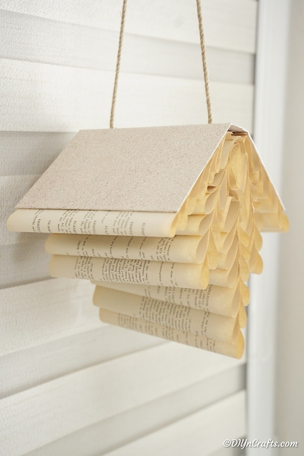 Rolled paper book decoration against siding wall