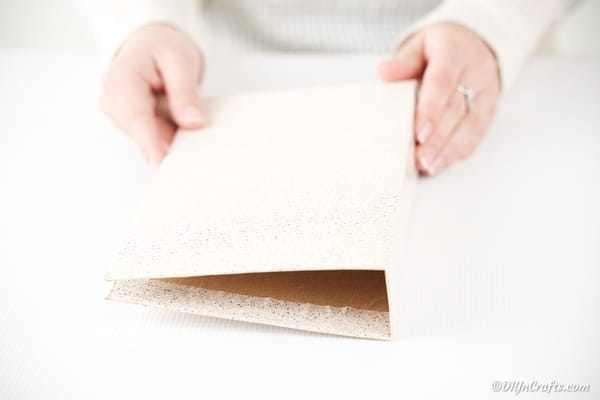 Folding cardboard into book shape