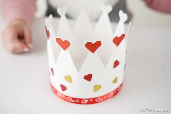 Adding hearts to paper crown