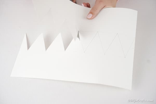 Cutting out crown from paper