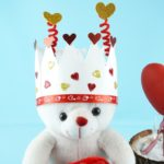 Valentine paper crown on white bear