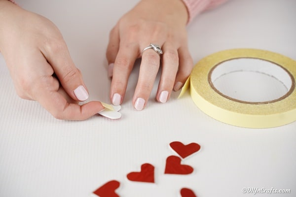 Cutting out hearts from glitter paper
