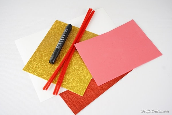 Supplies for making a paper crown