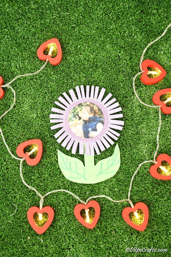 Paper flower card on grass