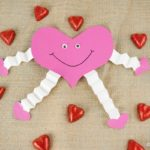 paper heart decoration on burlap with heart candy