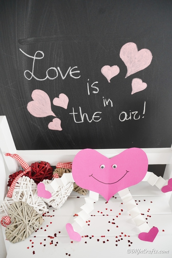 Paper heart on shelf in front of chalkboard