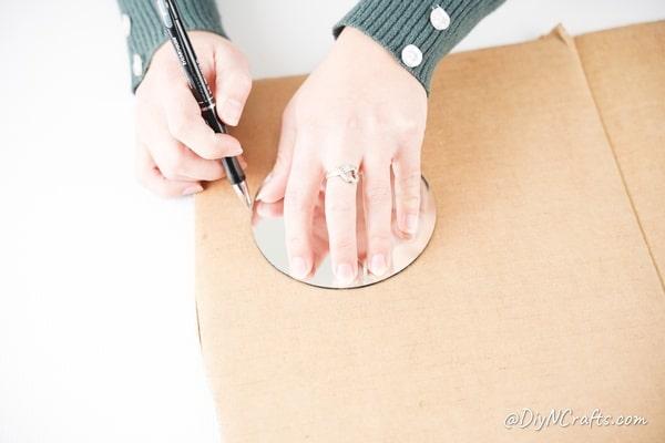 Tracing around mirror on cardboard