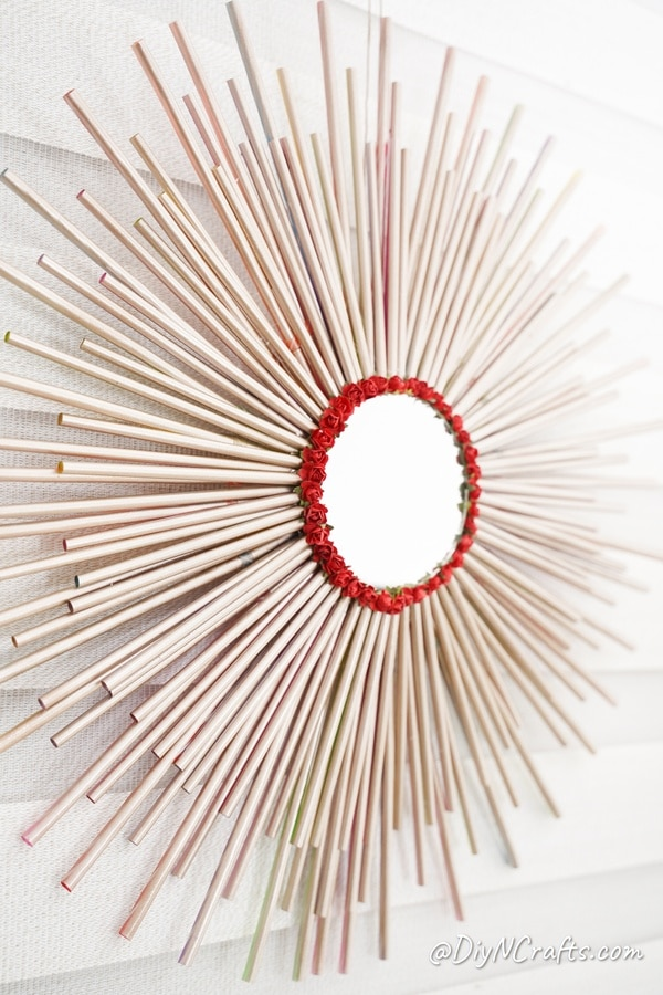 Paper straw wall art hanging on white wall
