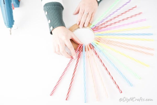 Gluing straws onto cardboard