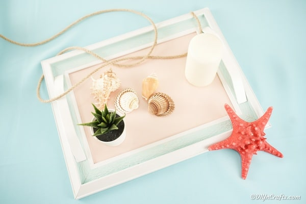 Picture frame tray with candle and plant