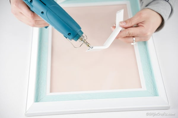 Adding drawer pull handles to picture frame