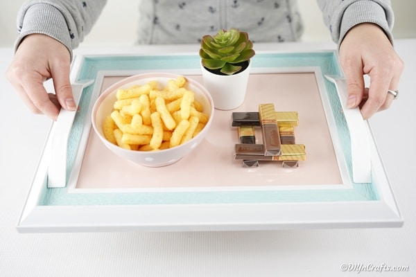 Picture frame tray with bowl of cheese puffs