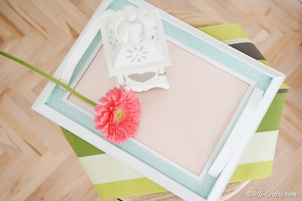 Picture frame tray with flower and lantern