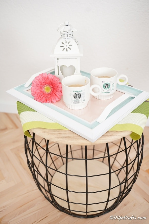 Picture frame tray on wooden table