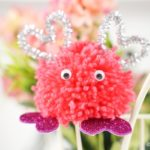 Valentine Monster Pom Pom in front of flowers