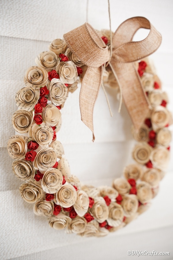 Paper rose valentine's day wreath on brick wall