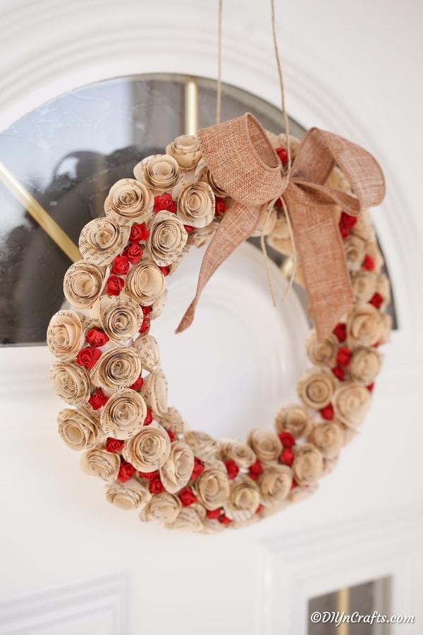 Quilled rose wreath hanging on front door
