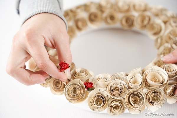Attaching artificial roses to quilled rose wreath