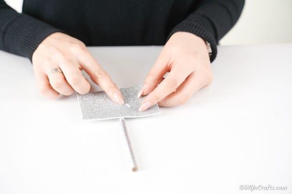 Attaching silver foam paper to pencil