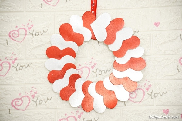 Valentine's Day wreath on a white surface with i love you stamp