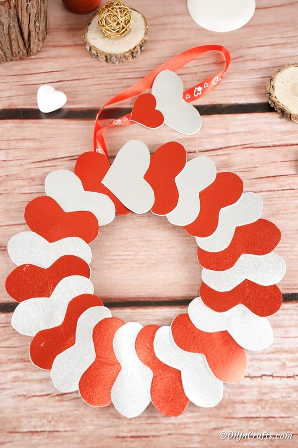 Heart valentine's day wreath laying on wood surface