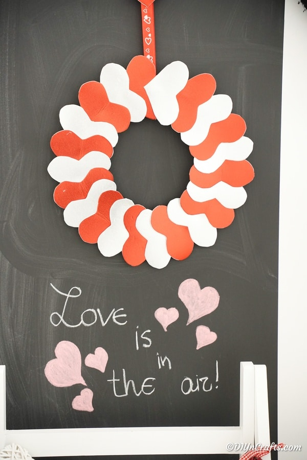 Heart wreath against chalkboard