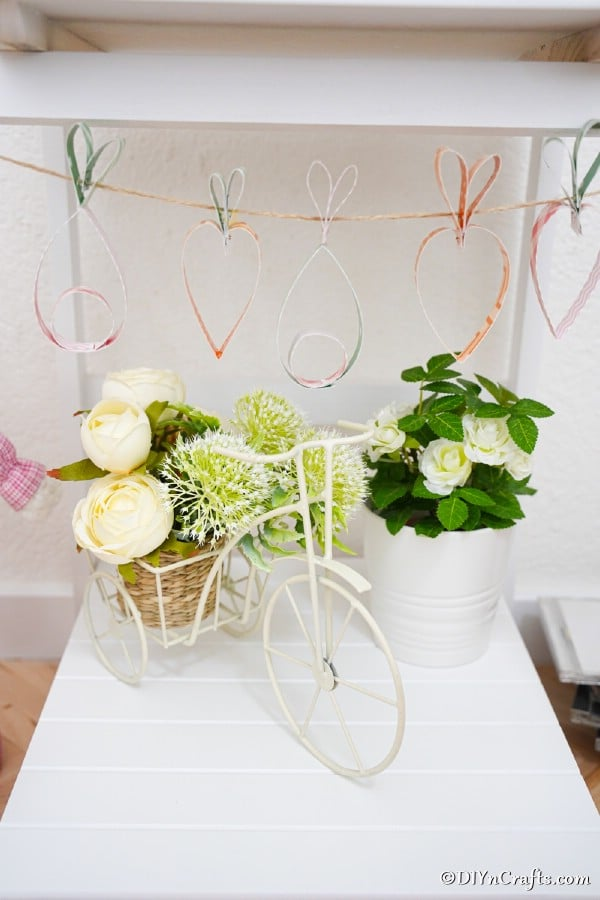 Easter garland hanging on white shelf