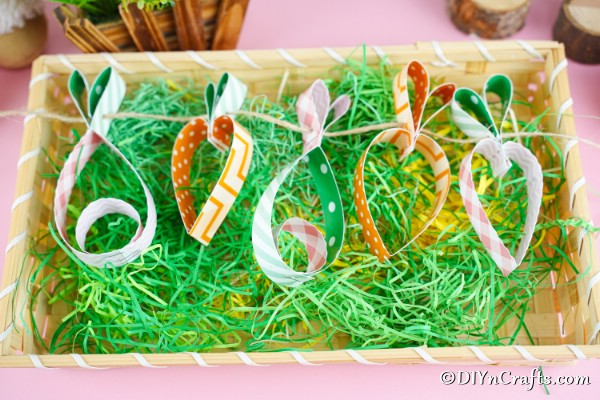Easter garland laying in basket with fake grass
