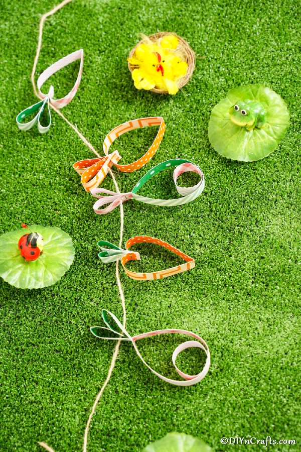 Easter egg garland on grass