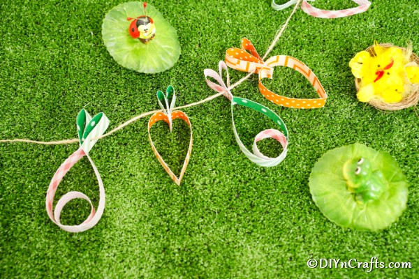 Carrot and egg easter garland on grass