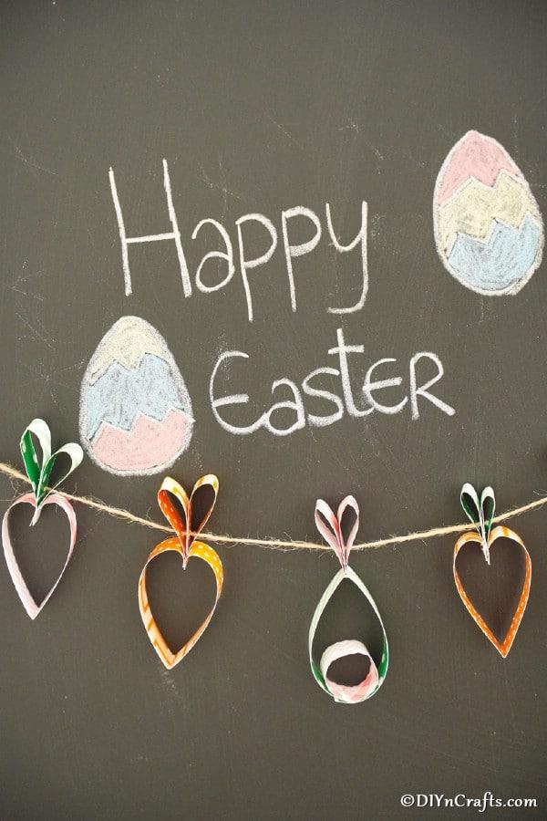 Easter garland hanging against chalkboard