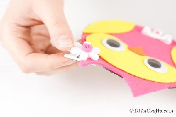 Gluing a flower bow on ear of owl cd messenger holder
