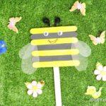 Craft stick bee on grass
