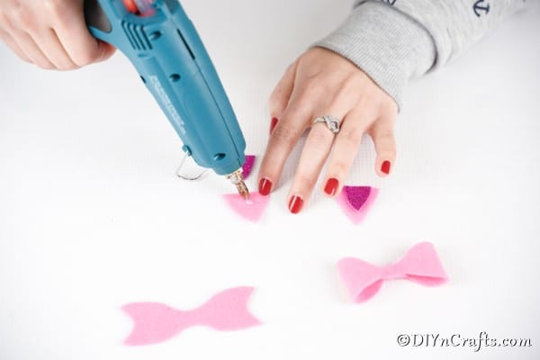 Gluing glitter foam onto triangles