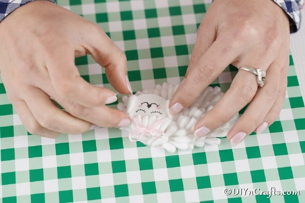 Gluing face onto cotton swab lamb