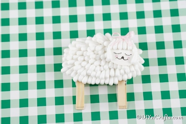 Cotton swab lamb on green check paper