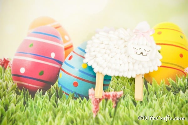 Cotton swab lamb in front of easter background