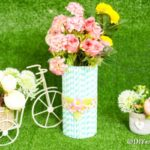 Paper straw mason jar vase on grass