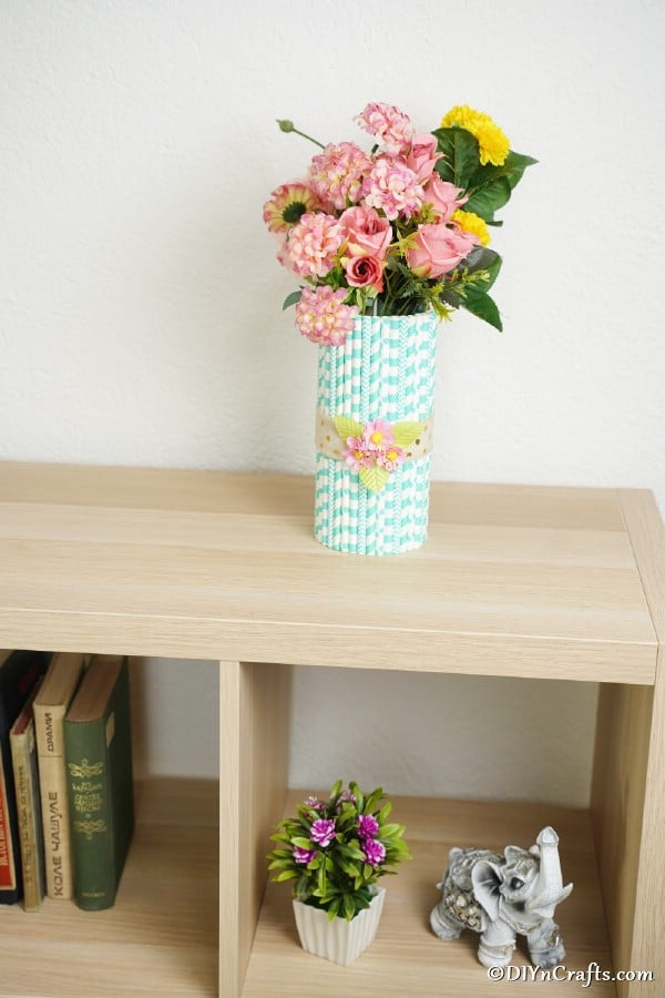 Mason jar vase on a shelf