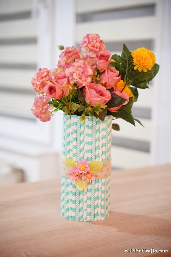 Mason jar vase on table filled with flowers