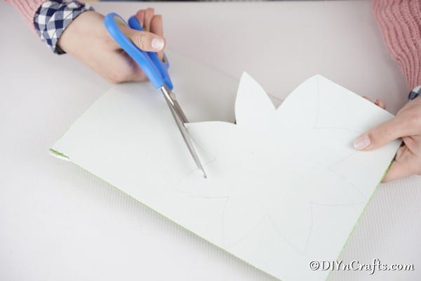 Use pointed template to cut out second color of foam paper