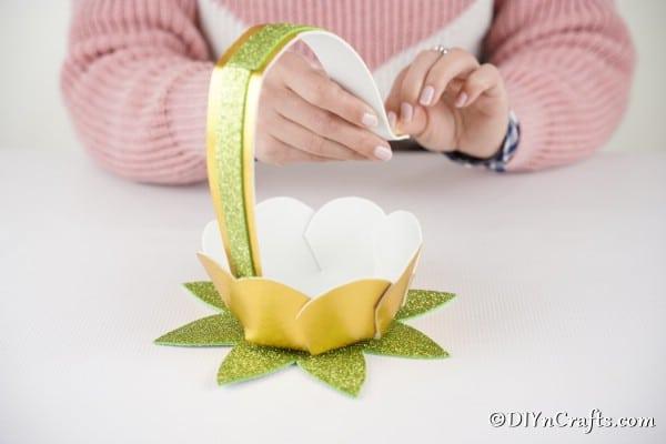 Gluing handle inside Easter egg basket