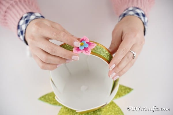 Add flower embellishments to mini basket