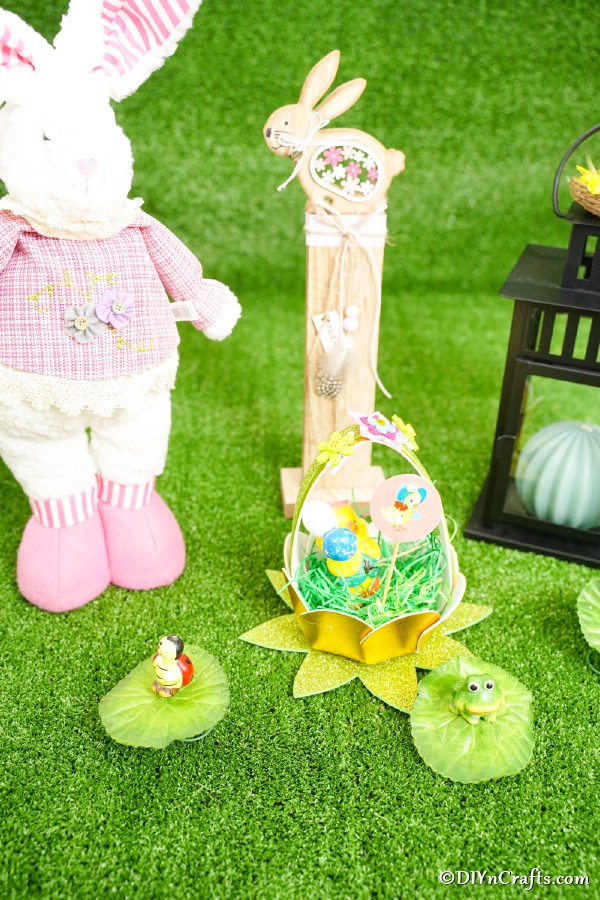 Eater egg basket on grass next to bunny toy