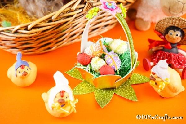 Easter egg basket on orange surface