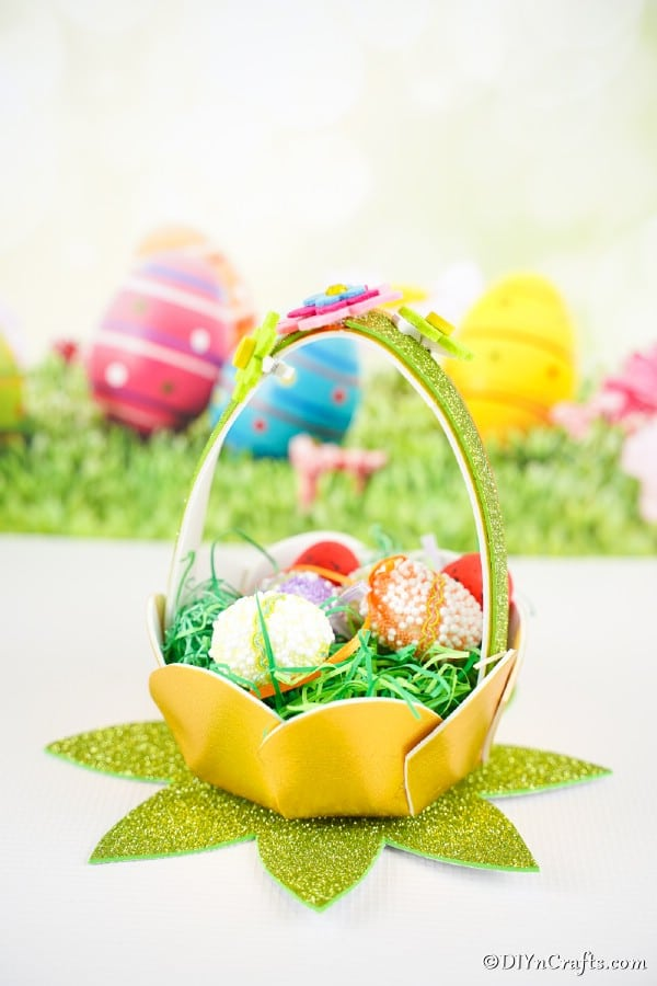 Eater egg basket in front of Easter background