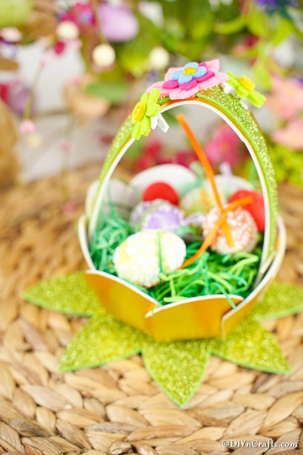 Glitter Easter egg basket on woven mat