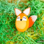 Easter egg fox decoration in fake green grass
